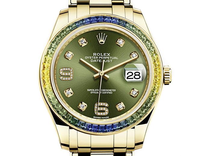 Rolex Pearlmaster 39 Oyster Gold mit grünnen Baguetten